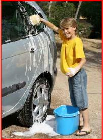 boy washes car to help